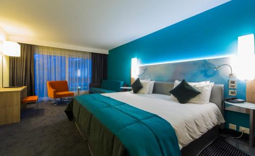 Кровать или кровати в номере Le Bristol Leukerbad