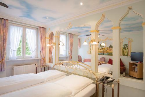 Ein Bett oder Betten in einem Zimmer der Unterkunft Hotel Plankl