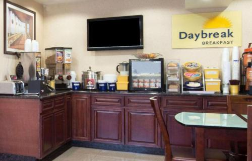 A television and/or entertainment centre at Days Inn by Wyndham Long Island/Copiague