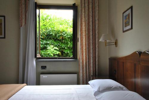 Кровать или кровати в номере Hotel Pavone