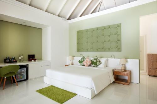 Кровать или кровати в номере Sun Siyam Olhuveli