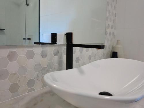 A bathroom at Bluewater Apartment