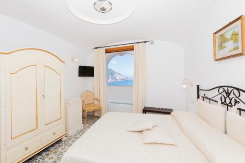 Letto o letti in una camera di Hotel Conca d'Oro