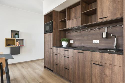 A kitchen or kitchenette at Ülemiste City Residences