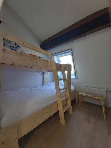 A bunk bed or bunk beds in a room at Ruyge Weyde Logies - The Farmers Daughter