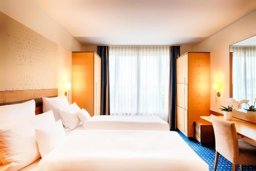 A bed or beds in a room at Welcome Hotel Wesel
