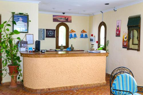 The lobby or reception area at Hôtel Mandy