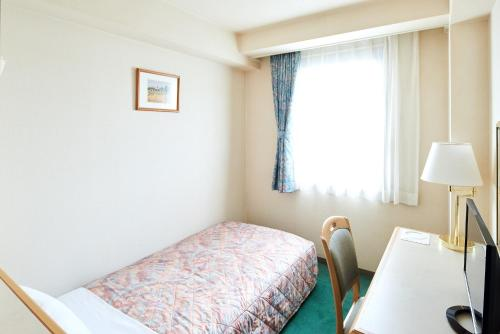 A bed or beds in a room at Marroad Inn Hanno