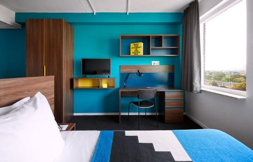 Cama o camas de una habitación en The Student Hotel The Hague