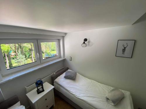 Łóżko lub łóżka w pokoju w obiekcie OWS Dorota