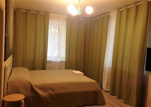 Кровать или кровати в номере Apartment Hanaka Federativniy 43