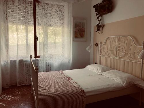 Letto o letti in una camera di La Collina di Albiro Affittacamere