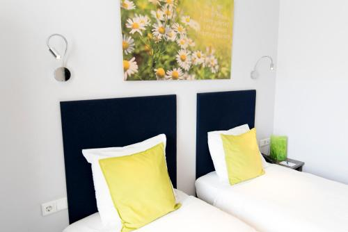 A bed or beds in a room at Court Garden Hotel - Ecodesigned