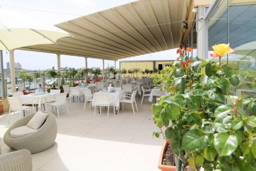 A restaurant or other place to eat at Marshal Garden Hotel