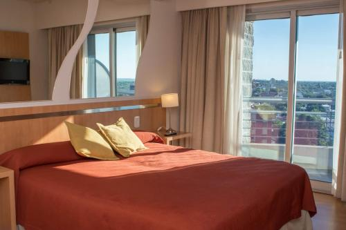 A bed or beds in a room at Maran Suites & Towers