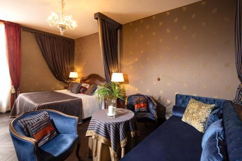 Ein Sitzbereich in der Unterkunft Hotel Metropole Venezia