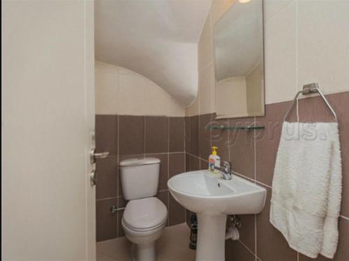 A bathroom at Pafilia Garden Apartments