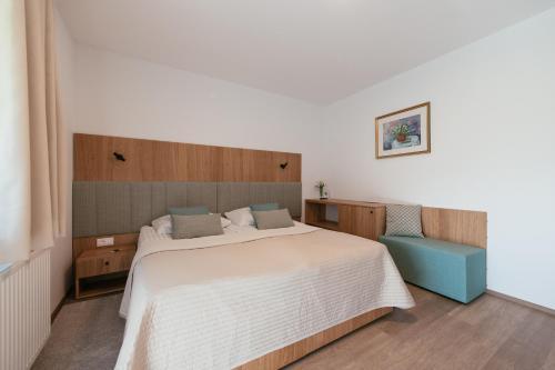 Postelja oz. postelje v sobi nastanitve Penzion Livada