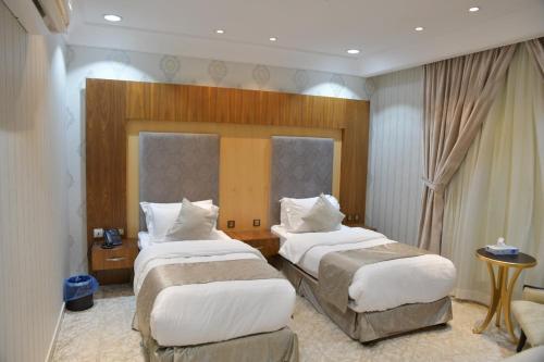 Cama ou camas em um quarto em Crown City Hotel - فندق كراون سيتي