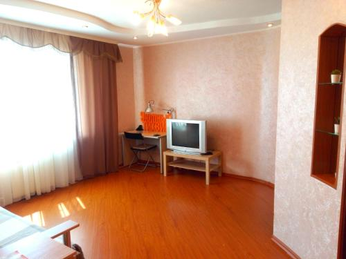 A television and/or entertainment center at Уютный Тихвин Апартаменты 3 Микрорайон 11