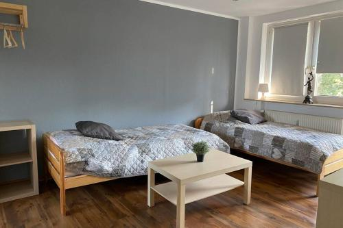 A bed or beds in a room at 2 Zimmer Apartment Duisburg Mitte