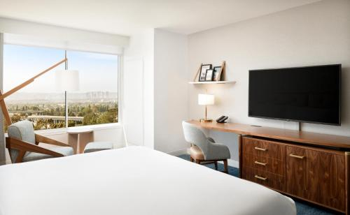 A television and/or entertainment center at Hilton Los Angeles-Culver City, CA