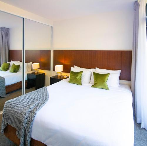 A bed or beds in a room at Mantra Wollongong
