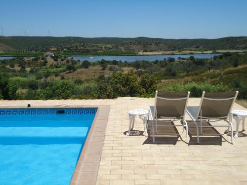 The swimming pool at or near Casa da Paz