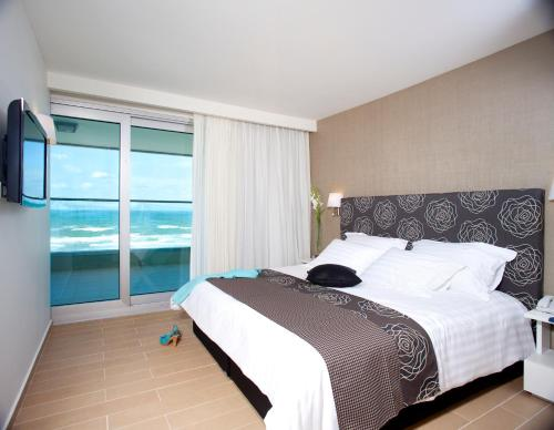 A bed or beds in a room at West All Suites Hotel Ashdod