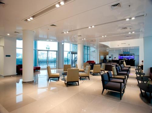 The lobby or reception area at West All Suites Hotel Ashdod