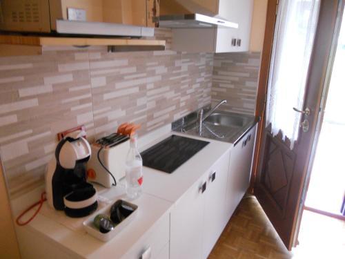 Kuchyň nebo kuchyňský kout v ubytování Casa Paola