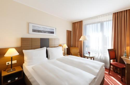 A bed or beds in a room at Best Western Hotel Bamberg