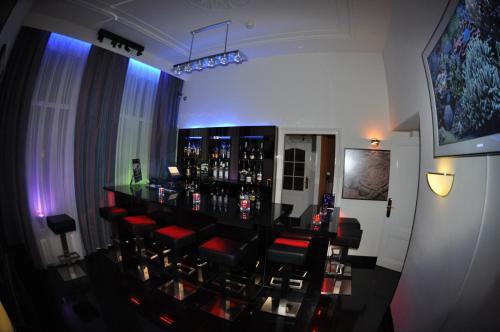 The lounge or bar area at Hotel Le Beau Rivage