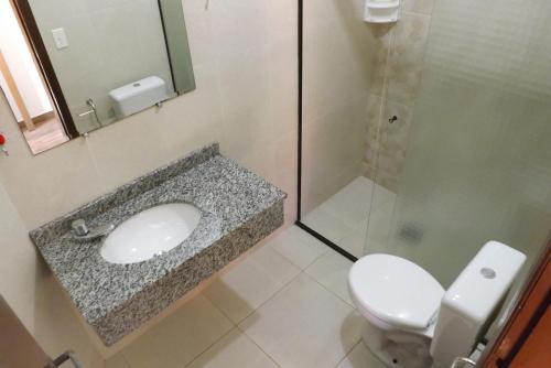 Um banheiro em Hotel Marazul