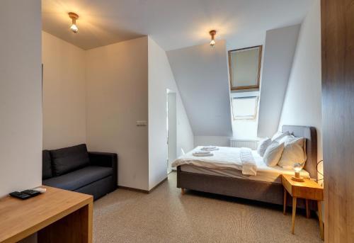 Posteľ alebo postele v izbe v ubytovaní Penzión Elements