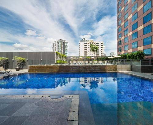 The swimming pool at or near Grand Mercure Singapore Roxy