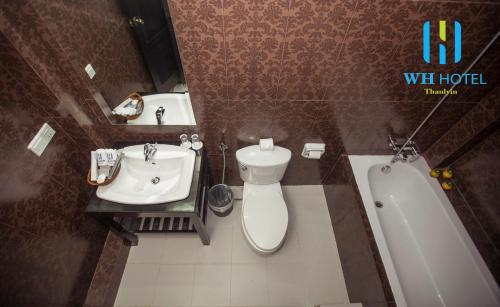 A bathroom at WH Hotel & Service Apartment