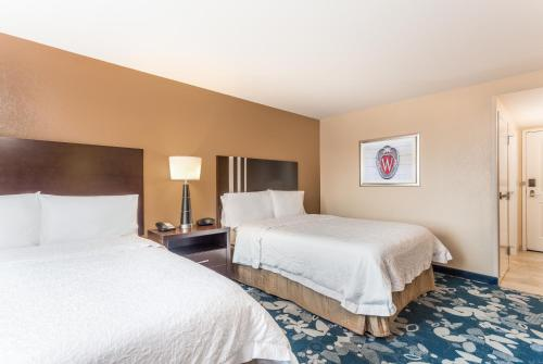 A bed or beds in a room at Hampton Inn & Suites Madison Downtown