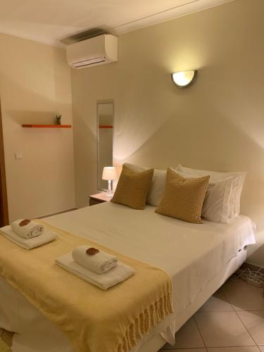 A bed or beds in a room at Blue Moon GuestHouse