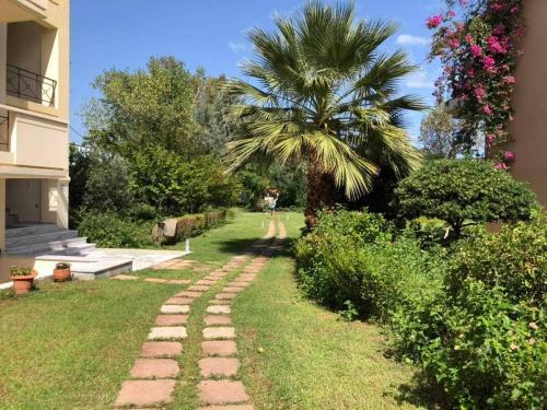 Κήπος έξω από το Marita's Apartments
