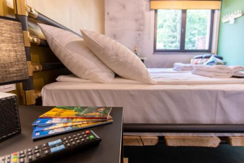 A bed or beds in a room at Timeout Heritage Hotel Zagreb