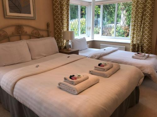 A bed or beds in a room at Hideaway Hull