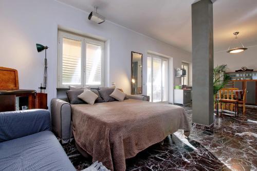Letto o letti in una camera di iFlat Stylish Penthouse near Marconi