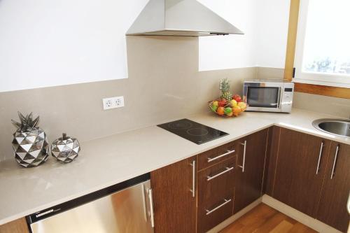 A kitchen or kitchenette at Augusta Eco Wellness Resort