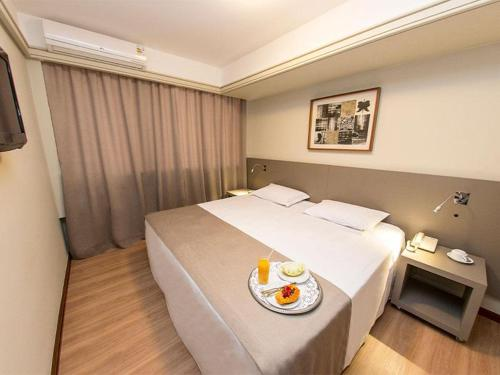 A bed or beds in a room at Alta Reggia Plaza Hotel
