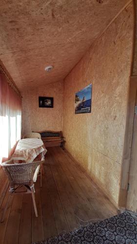 Кровать или кровати в номере Guest House Naberezhnaya on Buyane
