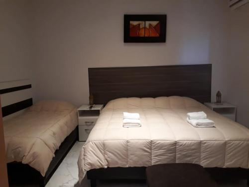 Una cama o camas en una habitación de Posada Villa Pituil
