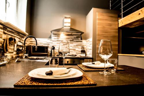 """A restaurant or other place to eat at """"Here"""" Mini loft Alghero"""