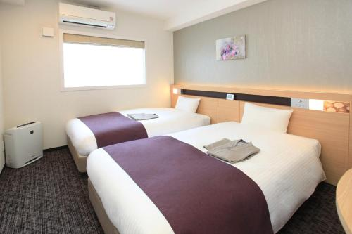 A bed or beds in a room at Urban Hotel Kyoto Nijo Premium