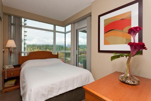 Ein Bett oder Betten in einem Zimmer der Unterkunft Lord Stanley Suites On The Park